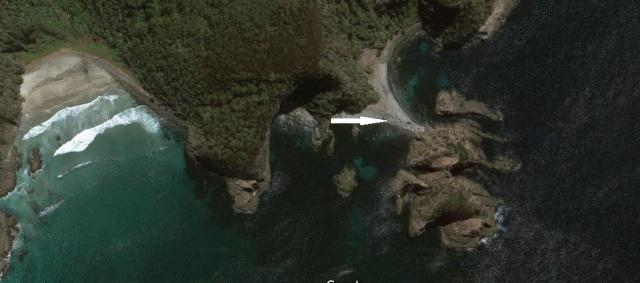 UK stony beach with arrow.jpg